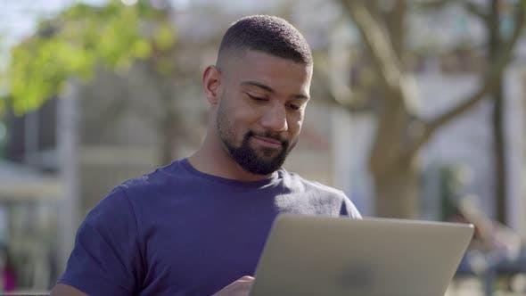 Thumbnail for Man Working on Laptop in Park, Thinking, Behaving Emotionally