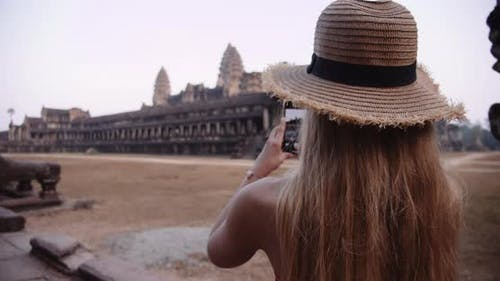 Blonde Person Capturing One of the Iconic Ruins in Cambodia