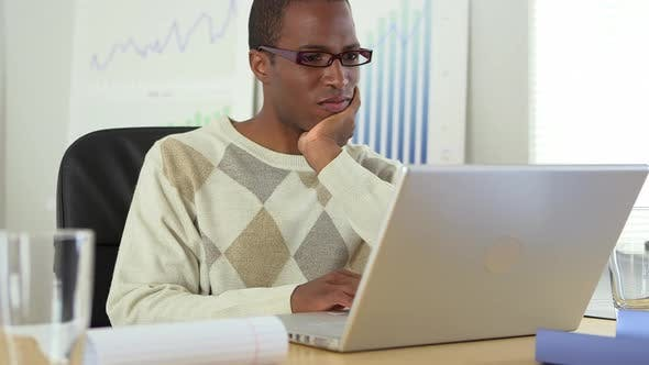Thumbnail for African American businessman working at laptop computer