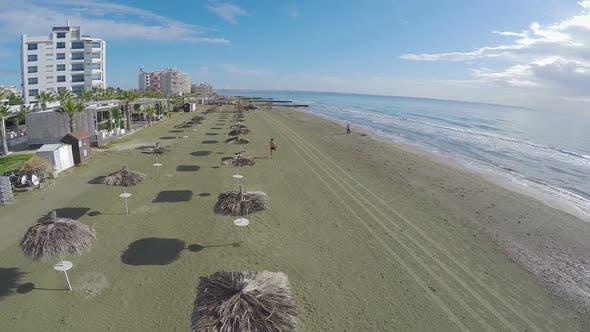 Thumbnail for Man Enjoying Vacation on Beach, Aerial View on Larnaca Coastline, Cyprus
