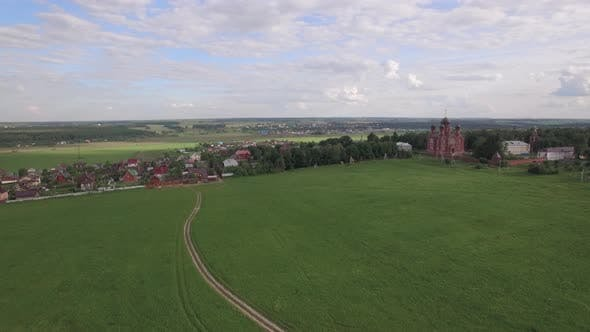 Thumbnail for Flying Over Green Meadows and Lukino Village in Russia
