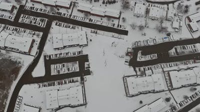 Town rooftops in city in snow covered houses in winter time