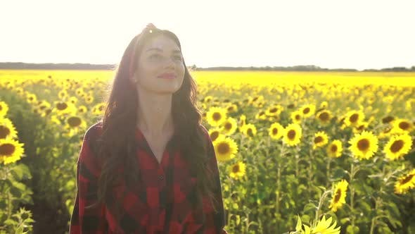 Thumbnail for Delighted Girl Enjoying Summer in Sunflower Field