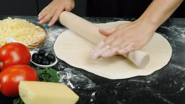 Rolling dough with rolling pin
