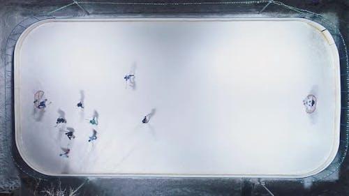 Playing Ice Hockey on Ice Rink