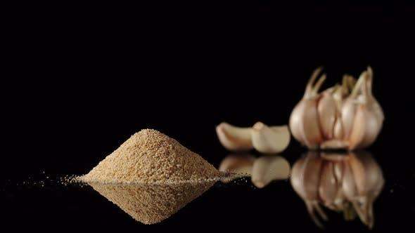 Thumbnail for Garlic Powder Appearing Near To Garlic Cloves