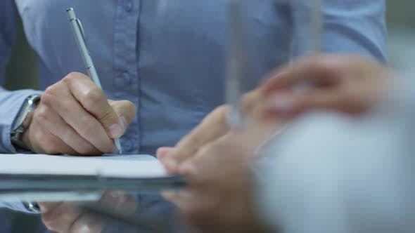 Thumbnail for Closeup of Male Hands Sighing Business Agreement