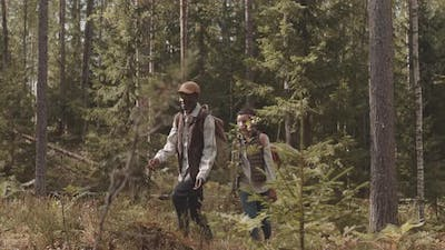 African-American Couple Hiking in Woods