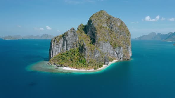 Thumbnail for Aerial Drone View of Karst Limestone Rocky Pinagbuyutan Island in Blue Sea of El Nido, Palawan