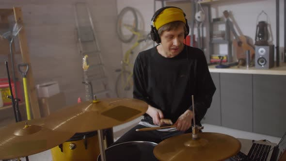 Thumbnail for Putting On Headphones And Starting Playing Drums