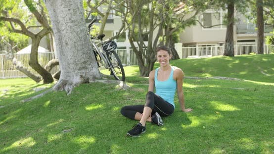 Thumbnail for Young woman sitting on grass