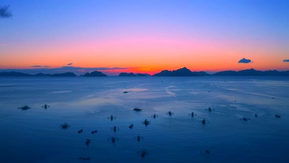 Thumbnail for Sail Boats at Sunset on the Sea Lagoon on Corong Beach in El Nido, Palawan, Philippines
