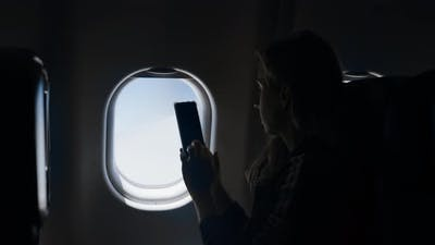 Taking Photo On The Plane