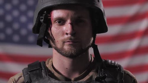 Portrait of Brave Military Man in Front US Flag
