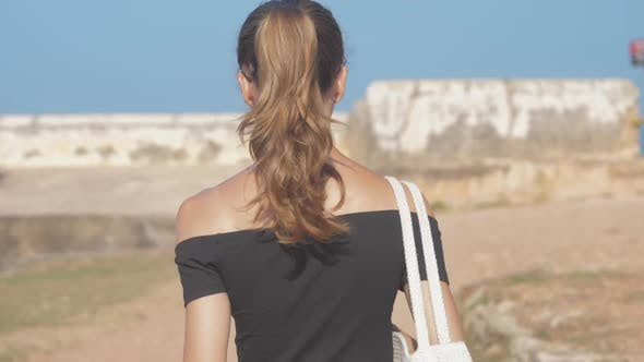 Thumbnail for Girl Gets Acquainted with Ancient Fort Sights Walking