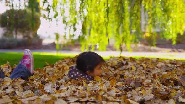 Thumbnail for Children playing in fall leaves. Shot on RED EPIC for high quality 4K, UHD, Ultra HD resolution.
