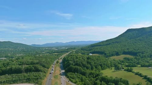 Aerial View of Highway Intersection Traffic Road in Daleville Town with Valley Mountains in West