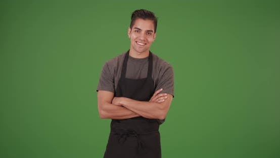 Thumbnail for Happy handsome young Latino waiter on green screen