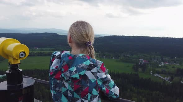 Thumbnail for Woman Looks at a Beautiful View on Top of a Mountain