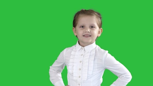 Thumbnail for Cute Little Girl in White Dress Posing on Camera on A Green