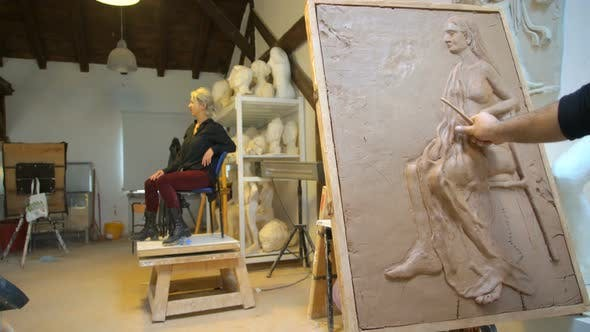 Sculptor is Modeling a Realistic, Figurative Relief with Model