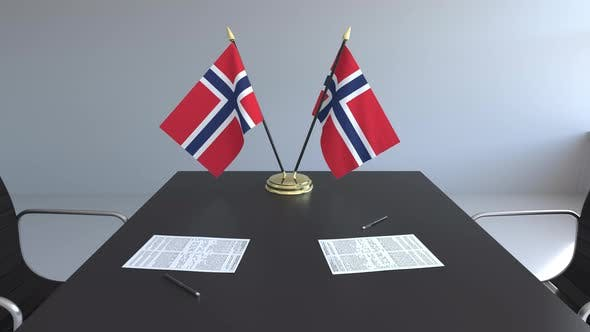 Flags of Norway and Papers on the Table