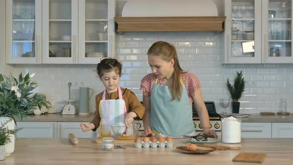 Thumbnail for Loving Mother and Daughter Prepare Holiday Cookies in the Kitchen, Knead the Dough. The Daughter