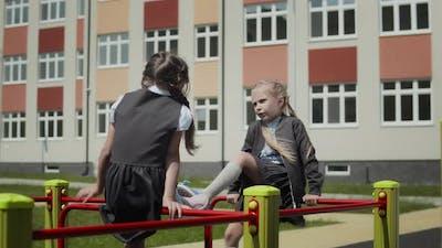Girlfriends talking in schoolyard