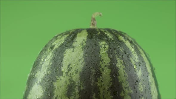 Sweet Watermelon With Water Drops On Green Background Studio