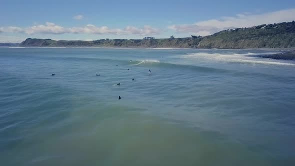 Surfers in New Zealand