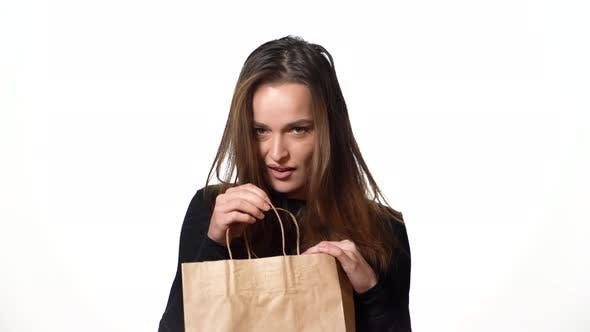 Thumbnail for Beautiful Woman in a Black Sweater Looks Mysteriously in a Paper Backpack