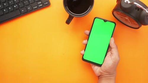 Top View of Man Hand Using Smart Phone on Office Desk