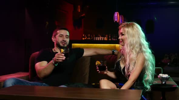 Thumbnail for Couple Smoke Hookah at Lounge Restaurant