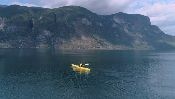 Thumbnail for Aerial Drone Shot of Yellow Kayak in Fjord Water