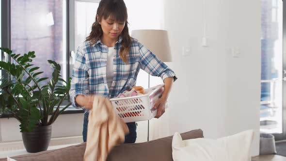Thumbnail for Asian Woman Picking Dirty Laundry at Home