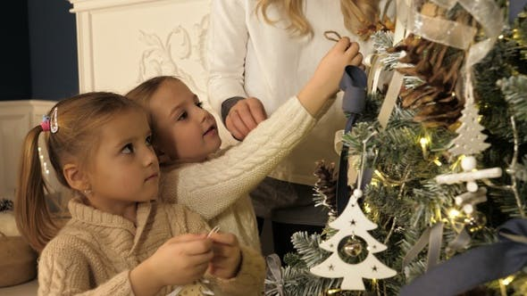 Thumbnail for Mother and children decorating Xmas tree in beautiful family
