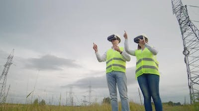 Energy Engineers Use Virtual Reality Glasses to Control the Solar Panel System and Deliver Energy to