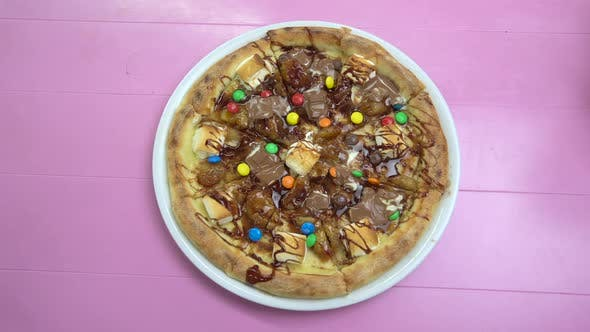 Thumbnail for Pizza with Melted Chocolate and Multicolored Candies