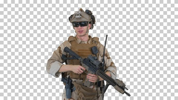 Smiling soldier with assault rifle talking, Alpha Channel