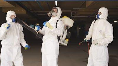 Team of Medical Workers in Hazmat Suits Dancing