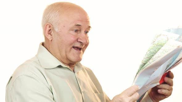 Thumbnail for Happy Senior Man Using a Map Smiling Joyfully