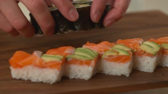Thumbnail for Sushi chef preparing sushi rolls