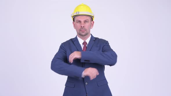 Thumbnail for Happy Businessman As Engineer with Arms Crossed