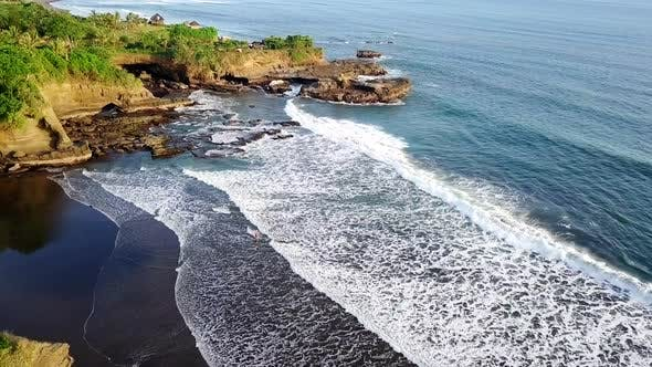 Cover Image for Drone Shot of Ocean Waves Crashing into Coast