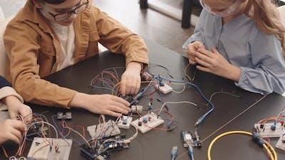 Pupils Constructing Robots in Classroom