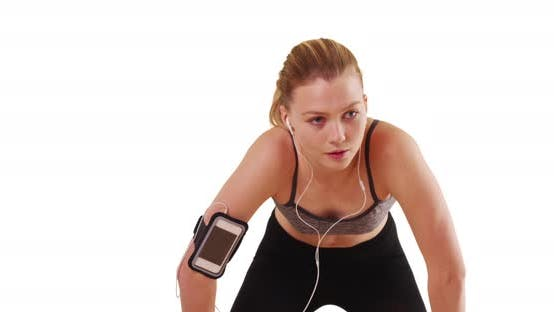 Thumbnail for Exhausted woman runner checks her smartwatch on white background with copyspace