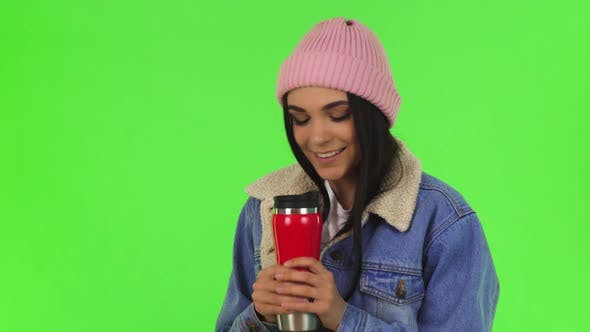 Thumbnail for Gorgeous Young Woman Wearing Warm Hat and Jacket Having Tea