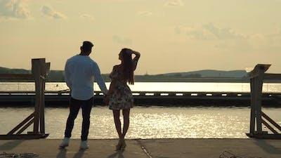 Romantic Couple Having Date on Embankment at Sunset