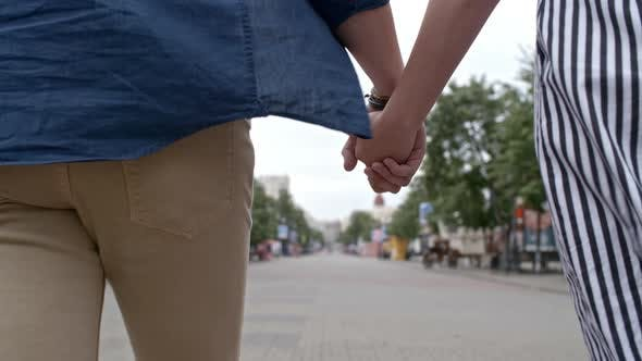 Cover Image for Close Up of Couple Holding Hands