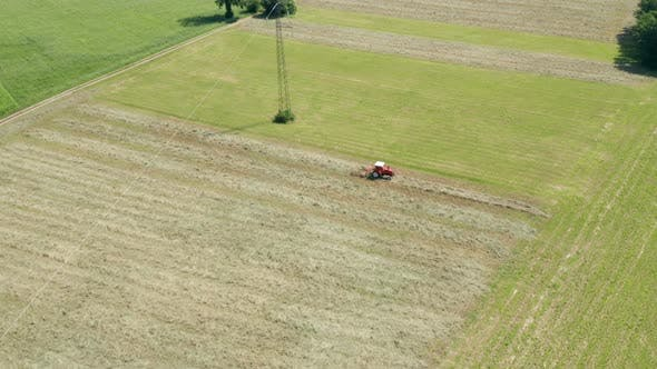 Thumbnail for Red Tractor Hay Tedder Aerial View